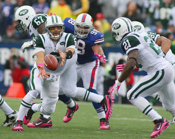 ORCHARD PARK, NY - OCTOBER 03: Mark Sanchez #6 pitches to LaDanian Tomlinson #21  of the New York Jets  the Buffalo Bills at Ralph Wilson Stadium on October 3, 2010 in Orchard Park, New York. The Jets won 38-14. (Photo by Rick Stewart/Getty Images)
