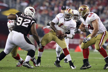GLENDALE, AZ - NOVEMBER 29:  Quarterback Troy Smith #1 of the San Francisco 49ers is sacked during the NFL game against the Arizona Cardinals at the University of Phoenix Stadium on November 29, 2010 in Glendale, Arizona. The 49ers defeated the Cardinals