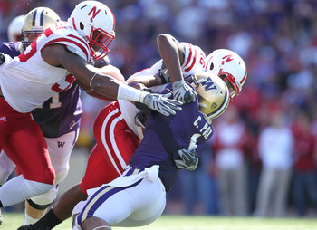 SEATTLE - SEPTEMBER 18: Running back Chris Polk #1 of the Washington Huskies is tackled by linebacker Eric Martin #46 and defensive end Pierre Allen #95 of the Nebraska Cornhuskers on September 18, 2010 at Husky Stadium in Seattle, Washington. (Photo by O