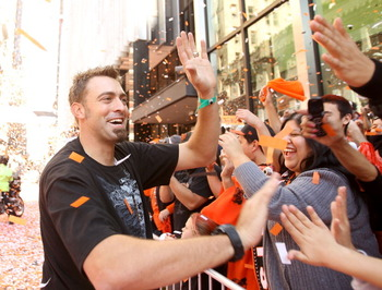 SAN FRANCISCO - NOVEMBER 03:  Jeremy Affeldt of the San Francisco Giants high fives fans during the San Francisco Giants victory parade on November 3, 2010 in San Francisco, California.  (Photo by Ezra Shaw/Getty Images)
