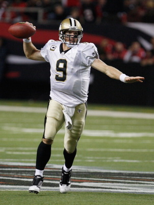 ATLANTA, GA - DECEMBER 27:  Quarterback Drew Brees #9 of the New Orleans Saints looks upfield to pass in the second half during the game against the Atlanta Falcons at the Georgia Dome on December 27, 2010 in Atlanta, Georgia.  (Photo by Scott Halleran/Ge