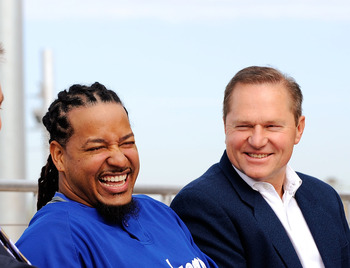 GLENDALE, AZ - MARCH 05:  Manny Ramirez#99, second right, smiles as his Agent Scott Boras (L) general manager Ned Colletti, second right, and manager Joe Torre look on during a news conference on March 5, 2009, at Camelback Ranch in Glendale, Arizona. Ram