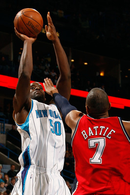 NEW ORLEANS - JANUARY 08:  Emeka Okafor #50 of the New Orleans Hornets shoots the ball over Tony Battie #7 of the New Jersey Nets at the New Orleans Arena on January 8, 2010 in New Orleans, Louisiana.  NOTE TO USER: User expressly acknowledges and agrees