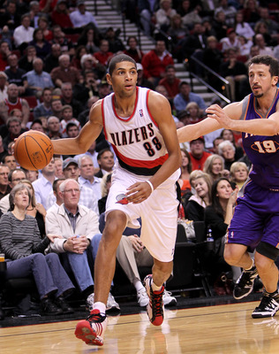 PORTLAND, OR - OCTOBER 26:  Nicolas Batum #88 dribbles the ball agaionst Hedo Tukgolu #19 of the Portland Trail Blazers of the Phoeninx Suns on October 26, 2010 at the Rose Garden in Portland, Oregon.  NOTE TO USER: User expressly acknowledges and agrees