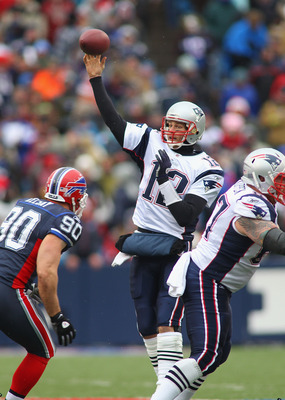 ORCHARD PARK, NY - DECEMBER 26:  Tom Brady #12 of the New England Patriots throws a pass against the Buffalo Bills at Ralph Wilson Stadium on December 26, 2010 in Orchard Park, New York.  (Photo by Rick Stewart/Getty Images)