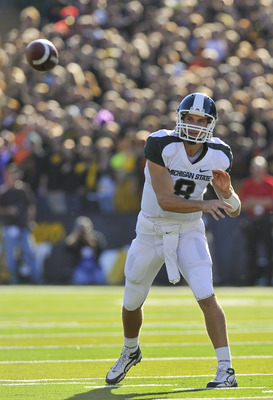 IOWA CITY, IA - OCTOBER 30- Quarterback Kirk Cousins #8 of the Michigan State Spartans throws a pass down field to a receiver during play against the University of Iowa Hawkeyes at Kinnick Stadium on October 30, 2010 in Iowa City, Iowa. Iowa won 37-6 over