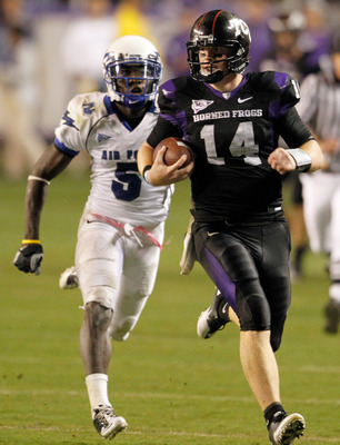 FORT WORTH, TX - OCTOBER 23:  Quarterback Andy Dalton #14 of the TCU Horned Frogs carries the ball against defensive back Anthony Wright Jr. #5 of the Air Force Falcons at Amon G. Carter Stadium on October 23, 2010 in Fort Worth, Texas.  TCU beat Air Forc
