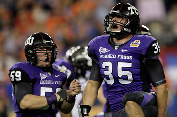 GLENDALE, AZ - JANUARY 04:  (R-L) Tanner Brock #35 and Logan Sligar #59 of the TCU Horned Frogs react after making a tackle in the first half against the Boise State Broncos during the Tostitos Fiesta Bowl at the Universtity of Phoenix Stadium on January