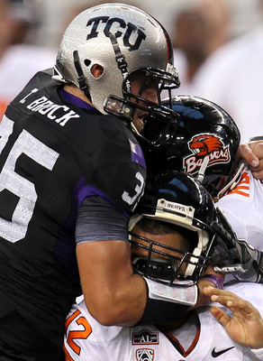 ARLINGTON, TX - SEPTEMBER 04:  Quarterback Ryan Katz #12 of the Oregon State Beavers is tackled by Tanner Brock #35 of the TCU Horned Frogs at Cowboys Stadium on September 4, 2010 in Arlington, Texas.  (Photo by Ronald Martinez/Getty Images)