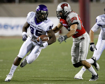 LAS VEGAS - OCTOBER 30:  Jeremy Kerley #85 of the Texas Christian University Horned Frogs runs for yardage against Alex De Giacomo #22 of the UNLV Rebels during the third quarter of their game at Sam Boyd Stadium October 30, 2010 in Las Vegas, Nevada. TCU