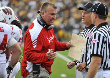 IOWA CITY, IA - OCTOBER 23- Head coach Bret Bielema of the Wisconsin Badgers debates a call with officials during the first half of play agains the University of Iowa Hawkeyes at Kinnick Stadium on October 23, 2010 in Iowa City, Iowa. Wisconsin won 31-30