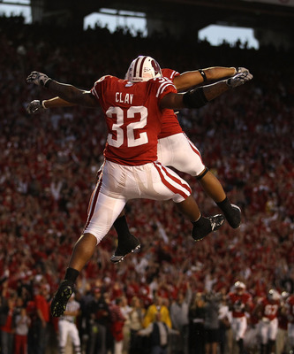 MADISON, WI - OCTOBER 16: John Clay #32 of the Wisconsin Badgers leaps to celebrate a touchdown against the Ohio State Buckeyes with teammate Nick Toon #1 at Camp Randall Stadium on October 16, 2010 in Madison, Wisconsin. (Photo by Jonathan Daniel/Getty I