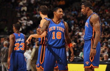 DENVER - NOVEMBER 16:  Roger Mason Jr. #18 and Amar'e Stoudemire #1 of the New York Knicks talk during a time out against the Denver Nuggets defends at the Pepsi Center on November 16, 2010 in Denver, Colorado. NOTE TO USER: User expressly acknowledges an