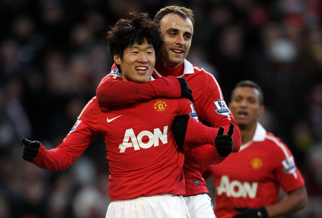 MANCHESTER, ENGLAND - NOVEMBER 27:  Ji-Sung Park (L) of Manchester United celebrates scoring his team's second goal with team mate Dimitar Berbatov  during the Barclays Premier League match between Manchester United and Blackburn Rovers at Old Trafford on