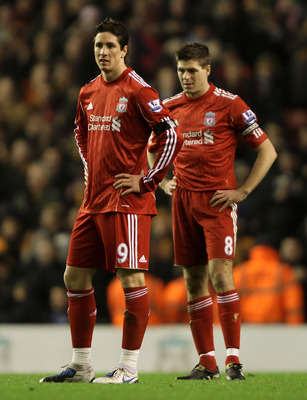 LIVERPOOL, ENGLAND - DECEMBER 29:  Fernando Torres and Steven Gerrard (R) of Liverpool look dejected after Wolverhampton Wanderers opened the scoring during the Barclays Premier League match between Liverpool and Wolverhampton Wanderers at Anfield on Dece