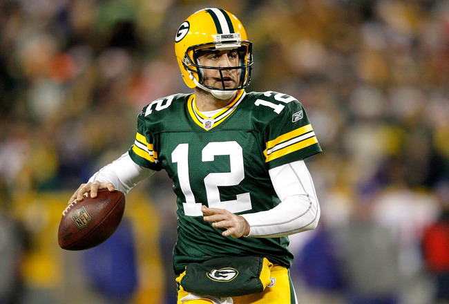 GREEN BAY, WI - DECEMBER 26:  Aaron Rodgers #12 of the Green Bay Packers rolls out of the pocket against the New York Giants at Lambeau Field on December 26, 2010 in Green Bay, Wisconsin.  (Photo by Matthew Stockman/Getty Images)