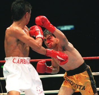 19 FEB 1994:  CHALLENGER HUMBERTO GONZALEZ THROWS A PUNCH AT CHAMPION MICHAEL CARBAJAL DURNG THEIR BOUT FOR THE IBF AND WBC LIGHT-FLY-WEIGHT TITLES. WAS CUT BY A CARBAJAL HEAD-BUTT IN THE THIRD ROUND. Mandatory Credit: Holly Stein/ALLSPORT