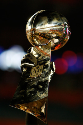 MIAMI GARDENS, FL - FEBRUARY 07:  A detail of the Vince Lombardi Trophy as the New Orleans Saints celebrate after defeating the Indianapolis Colts during Super Bowl XLIV on February 7, 2010 at Sun Life Stadium in Miami Gardens, Florida.  (Photo by Chris G