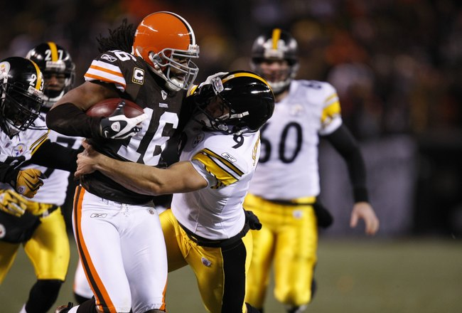 CLEVELAND - DECEMBER 10:  Joshua Cribbs #16 of the Cleveland Browns runs with the ball against Daniel Sepulveda #9 of the Pittsburgh Steelers on December 10, 2009 at Cleveland Browns Stadium in Cleveland, Ohio. Cleveland won the game 13-6.  (Photo by Greg