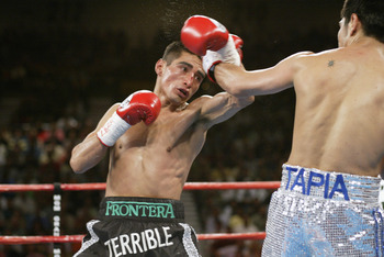 Las Vegas - June 22:   Erik Morales tries to counterattack against Marco Antonio Barrera during their World Featherweight Championship fight on June 22, 2002 at the MGM Grand Hotel/Casino in Las Vegas. (Photo by Jed Jacobsohn/Getty Images)