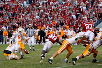 TUSCALOOSA, AL - OCTOBER 24:  Kicker Daniel Lincoln #26 of the Tennessee Volunteers kicks the game-winning field goal just before it is blocked by the Alabama Crimson Tide at Bryant-Denny Stadium on October 24, 2009 in Tuscaloosa, Alabama.  (Photo by Kevi