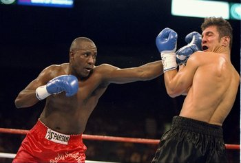 4 Mar 1994:  Mike McCallum and Randall Yonker in action during a bout in Las Vegas, Nevada.  McCallum won the fight with a TKO in the fifth round. Mandatory Credit: Al Bello  /Allsport