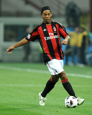 MILAN, ITALY - OCTOBER 16:  Ronaldinho of AC Milan runs with the ball during the Serie A match between AC Milan and AC Chievo Verona at Stadio Giuseppe Meazza on October 16, 2010 in Milan, Italy. (Photo by Massimo Cebrelli/Getty Images)