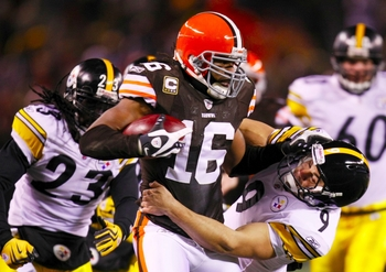 CLEVELAND - DECEMBER 10: Josh Cribbs #16 of the Cleveland Browns stiff-arms Daniel Sepulveda #9 of the Pittsburgh Steelers at Cleveland Browns Stadium on December 10, 2009 in Cleveland, Ohio. (Photo by Gregory Shamus/Getty Images)