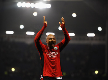 WEST BROMWICH, ENGLAND - DECEMBER 28:  El-Hadji Diouf of Blackburn Rovers celebrates an away victory during the Barclays Premier League match between West Bromwich Albion and Blackburn Rovers at The Hawthorns on December 28, 2010 in West Bromwich, England
