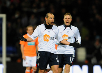 BOLTON, UNITED KINGDOM - NOVEMBER 27: Martin Petrov of Bolton celebrates after scoring his sides first goal during the Barclays Premier League match between Bolton Wanderers and Blackpool at the Reebok Stadium on November 27, 2010 in Bolton, England. (Pho