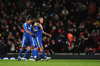 LONDON, ENGLAND - DECEMBER 27: (L-R) Didier Drogba, Frank Lampard and John Terry of Chelsea walk off dejected after the Barclays Premier League match between Arsenal and Chelsea at the Emirates Stadium on December 27, 2010 in London, England.  (Photo by S
