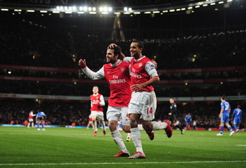 LONDON, ENGLAND - DECEMBER 27:  Cesc Fabregas of Arsenal celebrates Arsenal's second goal with Theo Walcott (R) during the Barclays Premier League match between Arsenal and Chelsea at the Emirates Stadium on December 27, 2010 in London, England.  (Photo b