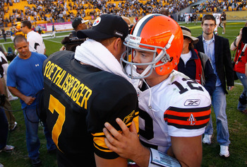 PITTSBURGH - OCTOBER 17:  Ben Roethlisberger #7 of the Pittsburgh Steelers talks to Colt McCoy #12 of the Cleveland Browns after defeating the Cleveland Browns 28-10 on October 17, 2010 at Heinz Field in Pittsburgh, Pennsylvania.  (Photo by Jared Wickerha