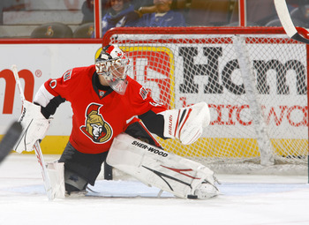 KANATA, ON - SEPTEMBER 29:  Robin Lehner #40 of the Ottawa Senators makes a glove save during warmup before a game against the Toronto Maple Leafs at Scotiabank Place on September 29, 2010 in Kanata, Canada.  (Photo by Phillip MacCallum/Getty Images)