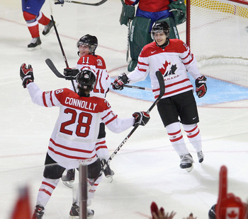 BUFFALO, NY - DECEMBER 29: Brett Connolly #28, Casey Cizikas #11 and Curtis Hamilton #16  of Canada celebrate Cizikas' goal in the first period against Norway during the 2011 IIHF World U20 Championship game between the Canada and Norway at the HSBC Arena
