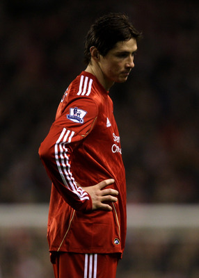 LIVERPOOL, ENGLAND - DECEMBER 29:  Fernando Torres of Liverpool looks dejected during the Barclays Premier League match between Liverpool and Wolverhampton Wanderers at Anfield on December 29, 2010 in Liverpool, England.  (Photo by Clive Brunskill/Getty I