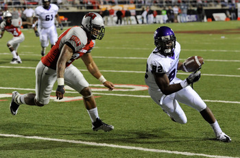 LAS VEGAS - OCTOBER 30:  Josh Boyce #82 of the Texas Christian University Horned Frogs runs for yardage after a reception against Starr Fuimaono #24 of the UNLV Rebels during the second quarter of their game at Sam Boyd Stadium October 30, 2010 in Las Veg