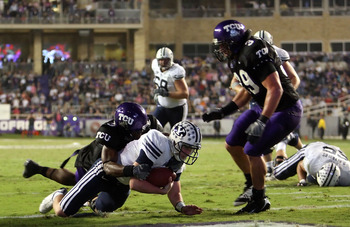 FORT WORTH, TX - OCTOBER 16:  Quarterback Max Hall #15 of the BYU Cougars dives for a touchdown against Tejay Johnson #3 of the TCU Horned Frogs in the third quarter at Amon G. Carter Stadium on October 16, 2008 in Fort Worth, Texas.  (Photo by Ronald Mar