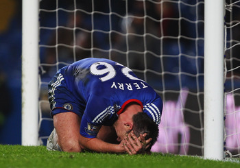 LONDON, UNITED KINGDOM - DECEMBER 29:  John Terry of Chelsea reacts during the Barclays Premier League match between Chelsea and Bolton Wanderers at Stamford Bridge on December 29, 2010 in London, England.  (Photo by Clive Rose/Getty Images)