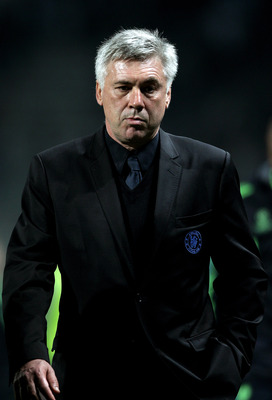 MARSEILLE, FRANCE - DECEMBER 08:  A dejected Carlo Ancelotti the Chelsea manager walks off the pitch following his team's 1-0 defeat during the UEFA Champions League Group F match between Marseille and Chelsea at the Stade Velodrome on December 8, 2010 in