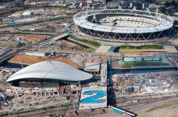 LONDON - JULY 21:   In this handout image provided by London 2012, an aerial view of the F10 bridge with construction workers from the Aquatics Centre forming a giant number 2 to signify 2 years until the start of London 2012 Olympic Games on July 21, 201