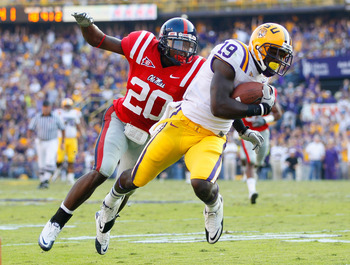 BATON ROUGE, LA - NOVEMBER 20:  Deangelo Peterson #19 of the Louisiana State University Tigers pulls in this reception against Johnny Brown #20 of the Ole Miss Rebels at Tiger Stadium on November 20, 2010 in Baton Rouge, Louisiana.  (Photo by Kevin C. Cox