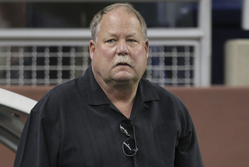DETROIT - AUGUST 28: Mike Holmgren President of the Cleveland Browns watches the action prior to the start of the preseason game against the Detroit Lions at Ford Field on August 28, 2010 in Detroit, Michigan. (Photo by Leon Halip/Getty Images)
