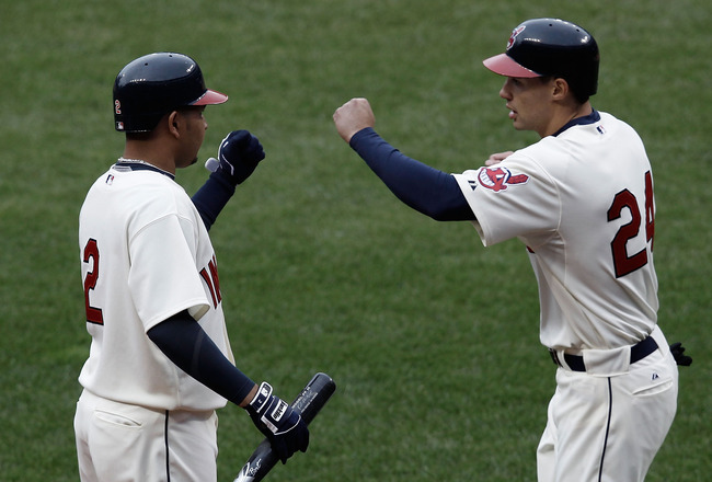 CLEVELAND, OH- APRIL 17: Grady Sizemore #24 is congratulated by teammate Jhonny Peralta #2 of the Cleveland Indians after scoring in the 8th inning against the Chicago White Sox during the game on April 17, 2010 at Progressive Field in Cleveland, Ohio.  (