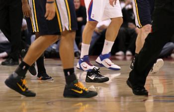 LOS ANGELES, CA - DECEMBER 29: Players walk past a loose shoe on the court during the game between the Utah Jazz and the Los Angeles Clippers at Staples Center on December 29, 2010 in Los Angeles, California.    NOTE TO USER: User expressly acknowledges a