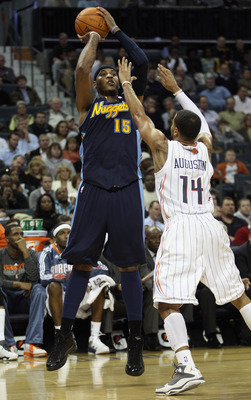 CHARLOTTE, NC - DECEMBER 07:  Carmelo Anthony #15 of the Denver Nuggets shoots over D.J. Augustin #14 of the Charlotte Bobcats during their game at Time Warner Cable Arena on December 7, 2010 in Charlotte, North Carolina.  NOTE TO USER: User expressly ack