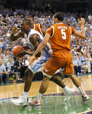 GREENSBORO, NC - DECEMBER 18:  Harrison Barnes #40 of the North Carolina Tar Heels drives past Cory Joseph #5 of the Texas Longhorns at Greensboro Coliseum on December 18, 2010 in Greensboro, North Carolina.  (Photo by Kevin C. Cox/Getty Images)