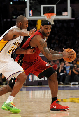LOS ANGELES, CA - DECEMBER 25:  LeBron James #6 of the Miami Heat drives against Kobe Bryant #24 of the Los Angeles Lakers at Staples Center on December 25, 2010 in Los Angeles, California. NOTE TO USER: User expressly acknowledges and agrees that, by dow