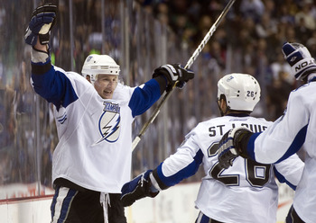 VANCOUVER, CANADA - DECEMBER 11: Steven Stamkos #91 of the Tampa Bay Lightning celebrates with Martin St Louis #26 after scoring against the Vancouver Canucks in overtime to win 5-4 during NHL action on December 11, 2010 at Rogers Arena in Vancouver, BC,