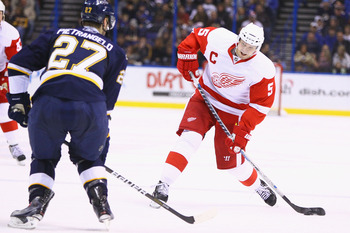 ST. LOUIS, MO - DECEMBER 23: Nicklas Lidstrom #5 of the Detroit Red Wings shoots the puck against the St. Louis Blues at the Scottrade Center on December 23, 2010 in St. Louis, Missouri.  (Photo by Dilip Vishwanat/Getty Images)